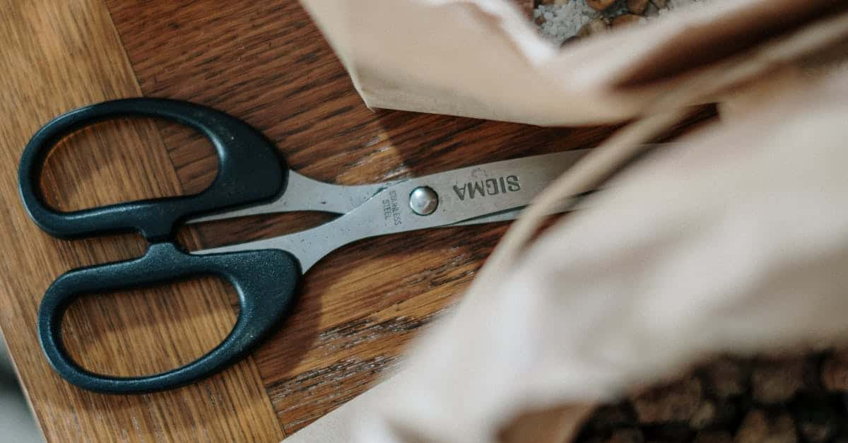A pair of scissors sitting on top of a wooden table
